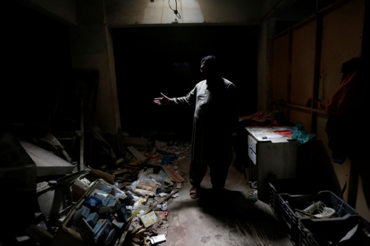 Zakir Hanif, an activist of Awami National Party, stands at his pharmacy store which was bombed by Tehreek-e-Taliban Pakistan, in Karachi, Pakistan January 25, 2017. REUTERS/Akhtar Soomro