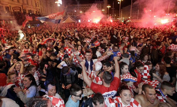 Croatian fans celebrate at the end of the semifinal match between Croatia and England, in Zagreb, Croatia, Wednesday, July 11, 2018. (AP Photo/Nikola Solic)