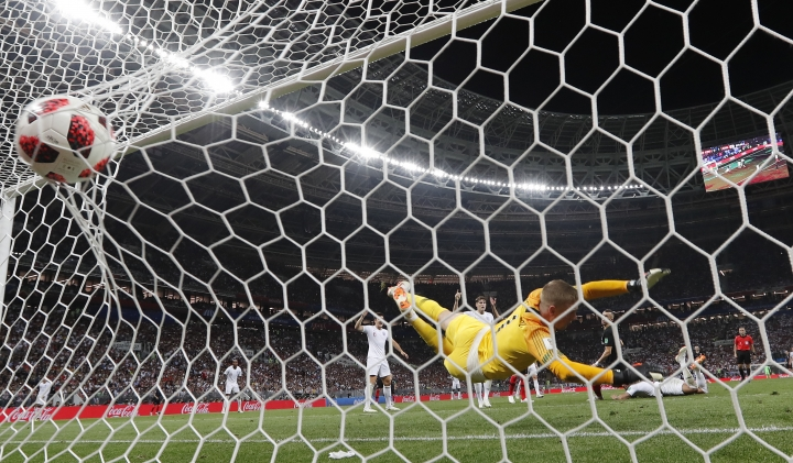 Croatia's Ivan Perisic scores his side's first goal past England goalkeeper Jordan Pickford during the semifinal match between Croatia and England at the 2018 soccer World Cup in the Luzhniki Stadium in Moscow, Russia, Wednesday, July 11, 2018. (AP Photo/Frank Augstein)