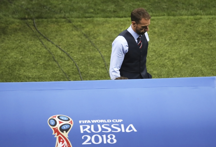 England head coach Gareth Southgate leaves the field at the end of the semifinal match between Croatia and England at the 2018 soccer World Cup in the Luzhniki Stadium in Moscow, Russia, Wednesday, July 11, 2018. (AP Photo/Thanassis Stavrakis)