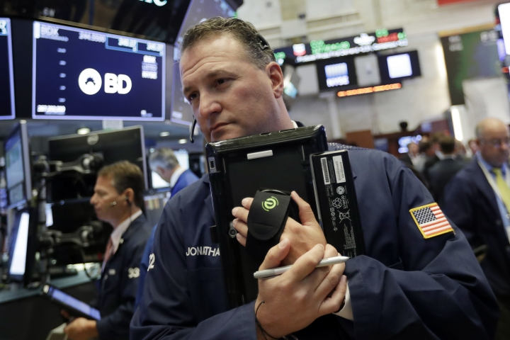 Trader Jonathan Corpina works on the floor of the New York Stock Exchange, Wednesday, July 11, 2018. Stocks are opening lower on Wall Street, following declines in Europe and Asia, after Washington threatened to expand tariffs on Beijing and China said it would retaliate. (AP Photo/Richard Drew)