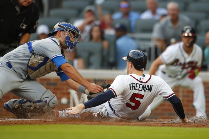 Atlanta Braves' Freddie Freeman (5) slides and avoids the tag of Toronto Blue Jays catcher Luke Maile to score during the second inning of a baseball game Wednesday, July 11, 2018, in Atlanta. (AP Photo/Todd Kirkland)