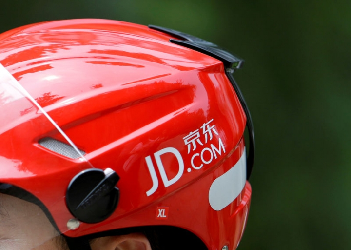 FILE PHOTO: A logo of JD.com is seen on a helmet of a delivery man in Beijing, China June 16, 2014. Picture taken June 16, 2014. REUTERS/Jason Lee/File Photo