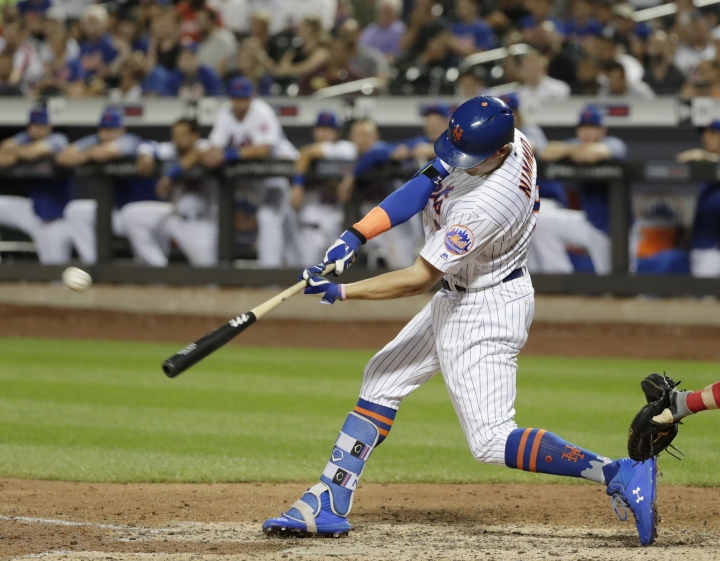 New York Mets' Brandon Nimmo hits a game-winning three-run home run during the 10th inning of a baseball game against the Philadelphia Phillies on Wednesday, July 11, 2018, in New York. The Mets won 3-0. (AP Photo/Frank Franklin II)