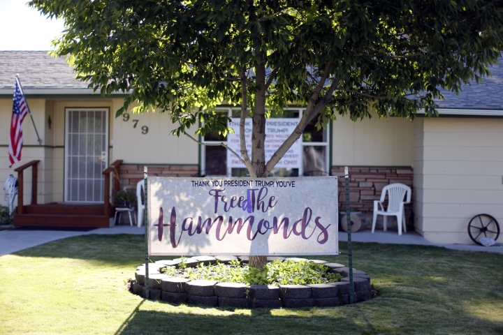 A thank you sign is displayed in a the family's yard thanking President Donal Trump to pardoning rancher Dwight and Steven Hammond, Wednesday, July 11, 2018, in Burns, Ore. Hammond and his son Steven, convicted of intentionally setting fires on public land in Oregon, were pardoned by President Donald Trump on Tuesday, July 10. (Beth Nakamura/The Oregonian via AP)
