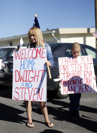 Supporters wait for ranchers Dwight and Steven Hammond to arrive by private jet at the Burns Municipal Airport, Wednesday, July 11, 2018, in Burns, Ore. Hammond and his son Steven, convicted of intentionally setting fires on public land in Oregon, were pardoned by President Donald Trump on Tuesday, July 10. (Beth Nakamura/The Oregonian via AP)