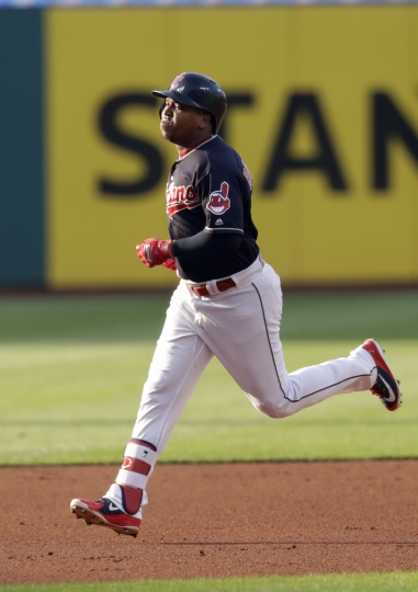 Cleveland Indians' Jose Ramirez runs the bases after hitting a two-run home run off Cincinnati Reds starting pitcher Tyler Mahle during the first inning of a baseball game Wednesday, July 11, 2018, in Cleveland. (AP Photo/Tony Dejak)