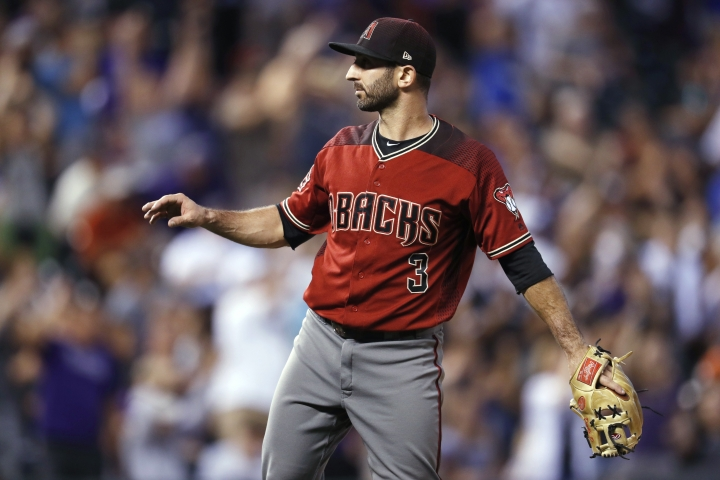 Arizona Diamondbacks infielder-turned-relief-pitcher Daniel Descalso calls for a new ball after giving up a three-run home run to Colorado Rockies' Carlos Gonzalez during the fourth inning of a baseball game Wednesday, July 11, 2018, in Denver. (AP Photo/David Zalubowski)