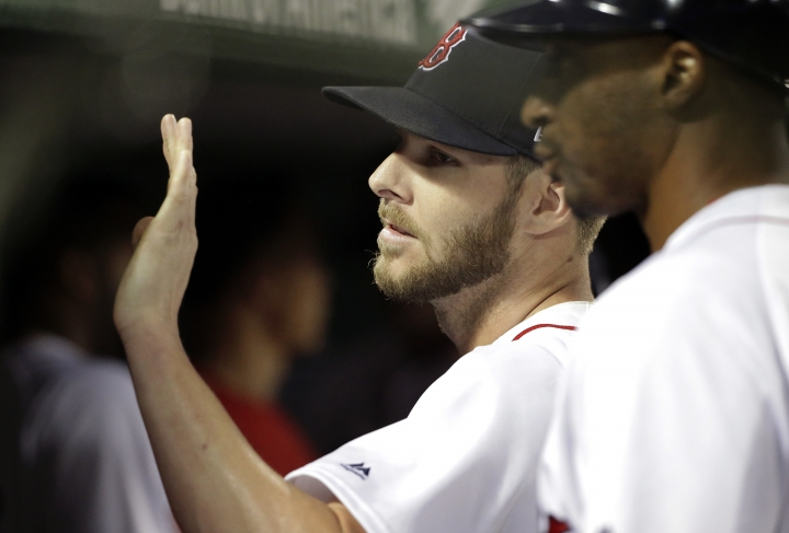 Boston Red Sox's Chris Sale is welcomed to the dugout after pitching in the seventh inning of a baseball game against the Texas Rangers, Wednesday, July 11, 2018, in Boston. Sale pitched seven scoreless innings with 12 strikeouts. (AP Photo/Steven Senne)