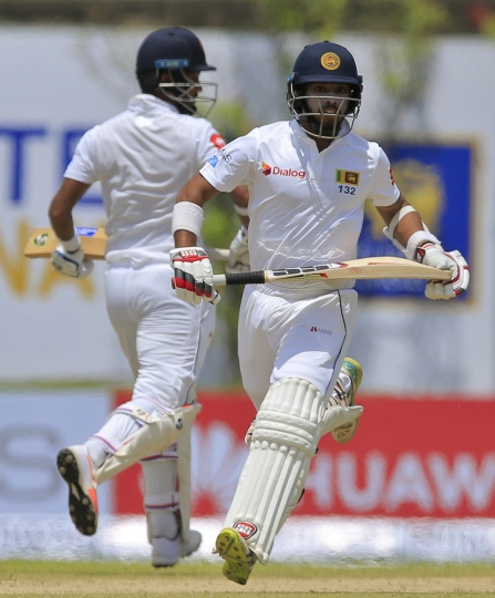 Sri Lanka's Dimuth Karunaratne, left, and Kusal Mendis run between wickets against South Africa during the first day's play of their first test cricket match in Galle, Sri Lanka, Thursday, July 12, 2018. (AP Photo/Eranga Jayawardena)