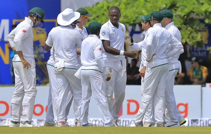 South African team members congratulate Kagiso Rabada, facing camera, for the dismissal of Sri Lanka's Danushka Gunathilaka during the first day's play of their first test cricket match in Galle, Sri Lanka, Thursday, July 12, 2018. (AP Photo/Eranga Jayawardena)