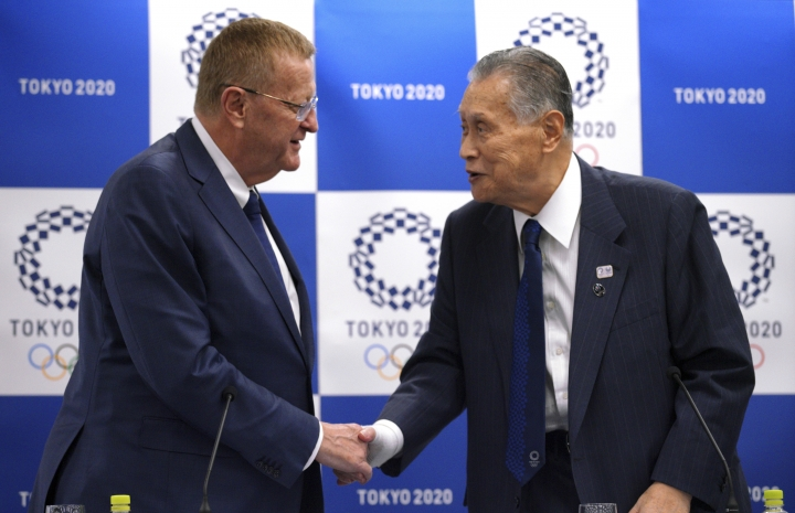 John Coates, left, chairman of the IOC Coordination Commission for the 2020 Tokyo Olympics and Paralympics, and Tokyo Olympic organizing committee President Yoshiro Mori, right, shake hands after the IOC and Tokyo 2020 joint press conference in Tokyo Thursday, July 12, 2018. (AP Photo/Eugene Hoshiko)