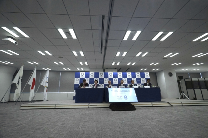 John Coates, third from left, chairman of the IOC Coordination Commission for the 2020 Tokyo Olympics and Paralympics and Tokyo Olympic organizing committee President Yoshiro Mori, fourth from left, attend the IOC and Tokyo 2020 joint press conference in Tokyo Thursday, July 12, 2018. (AP Photo/Eugene Hoshiko)