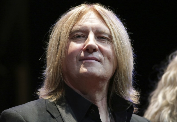 FILE PHOTO: Def Leppard singer Joe Elliott sits on stage during an announcement that Kiss and Def Leppard will team up this summer for a 42-city North American tour, at the House of Blues in West Hollywood, California March 17, 2014. REUTERS/Jonathan Alcorn
