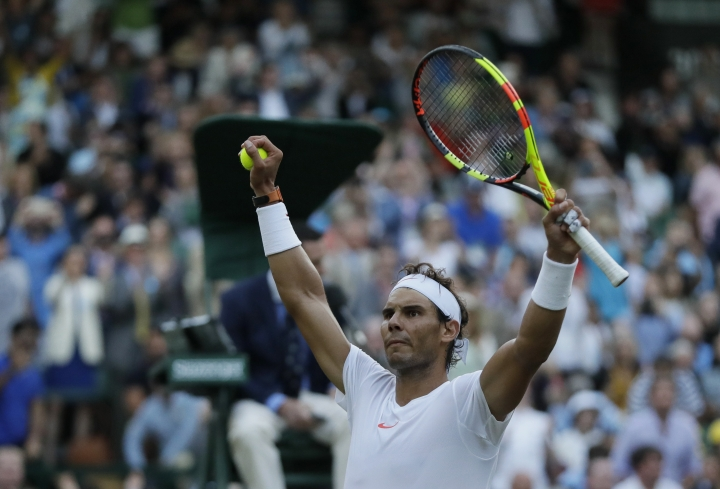 Rafael Nadal of Spain celebrates defeating Juan Martin Del Potro of Argentina in their men's quarterfinal match at the Wimbledon Tennis Championships in London, Wednesday July 11, 2018. (AP Photo/Kirsty Wigglesworth)