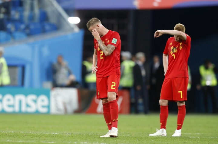 Belgium's Toby Alderweireld, left, and Belgium's Kevin De Bruyne stand on the pitch at the end of the semifinal match between France and Belgium at the 2018 soccer World Cup in the St. Petersburg Stadium, in St. Petersburg, Russia, Tuesday, July 10, 2018. (AP Photo/David Vincent)