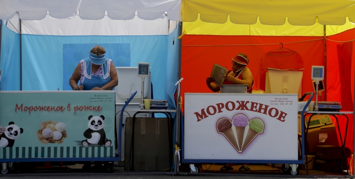 Two ice cream sellers prepare for business at their stand during the 2018 soccer World Cup in Nizhny Novgorod, Russia, Saturday, July 7, 2018. (AP Photo/Petr David Josek)