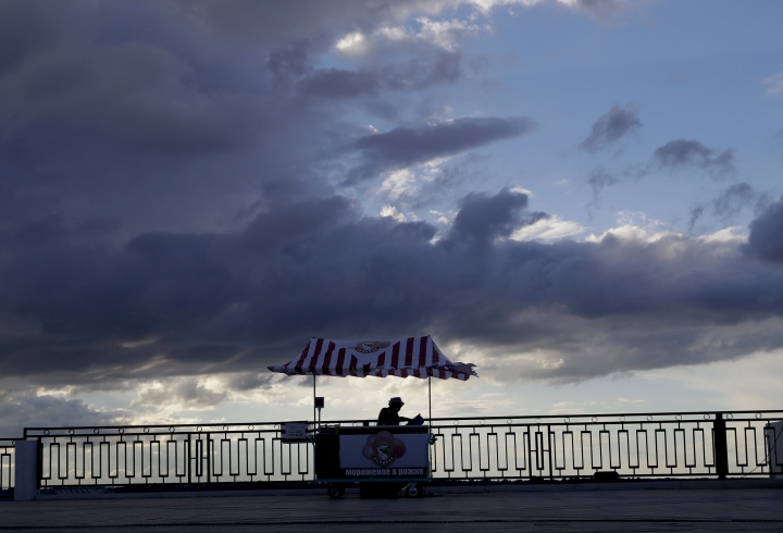 An ice cream seller attends her stand during the 2018 soccer World Cup in Nizhny Novgorod, Russia, Thursday, July 5, 2018. (AP Photo/Petr David Josek)