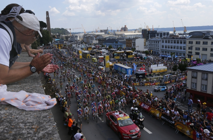 Spectators watch the start of the sixth stage of the Tour de France cycling race over 181 kilometers (112.5 miles) with start in Brest and finish in Mur-de-Bretagne Guerledan, France, Thursday, July 12, 2018. (AP Photo/Peter Dejong)