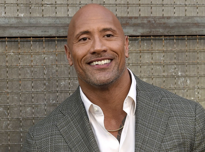 "FILE - In this April 4, 2018 file photo, Dwayne Johnson arrives at the world premiere of ""Rampage"" at the Microsoft Theater in Los Angeles. Johnson, who plays an amputee in the action movie ""Skyscraper"" said Thursday, July 12, he is joining the Boston-based Ruderman Family Foundation, calling for more inclusion and opportunities for people with disabilities in the entertainment industry. (Photo by Chris Pizzello/Invision/AP, File)"
