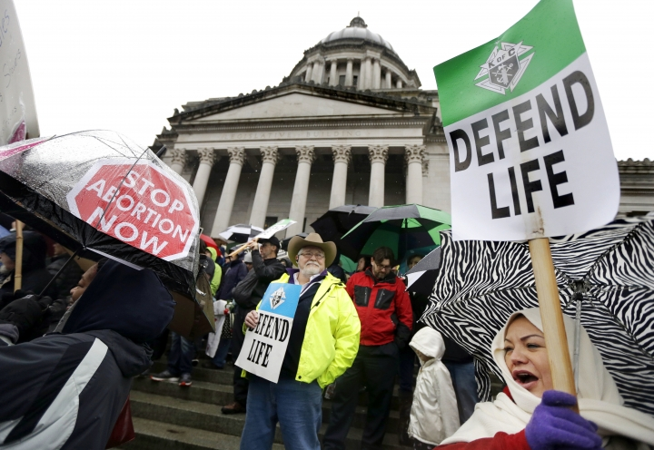 FILE - In this Jan. 19, 2016, file photo, demonstrators opposing abortion take part in a rally at the Capitol, in Olympia, Wash. If a Supreme Court majority shaped by President Donald Trump overturns or weakens the right to abortion, the fight over its legalization could return to the states. (AP Photo/Ted S. Warren, File)