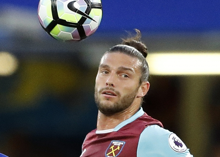 FILE - In this file photo dated Monday, Aug. 15, 2016, West Ham's Andy Carroll during the English Premier League soccer match against Chelsea at Stamford Bridge stadium in London. Carroll has suffered setbacks in his recovery from injuries suffered last season, it is reported Thursday July 12, 2018, and faces three more months out of action.(AP Photo/Frank Augstein, FILE)