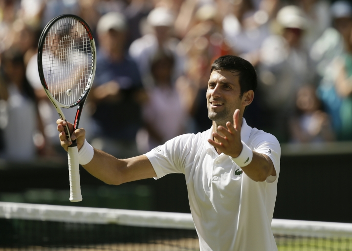 Novak Djokovic of Serbia celebrates defeating Kei Nishikori of Japan during their men's quarterfinal match at the Wimbledon Tennis Championships in London, Wednesday July 11, 2018. (AP Photo/Tim Ireland)