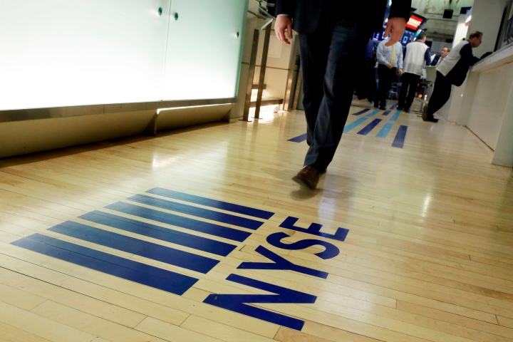 FILE- In this April 5, 2018, file photo, an NYSE logo adorns the entrance to the trading floor the New York Stock Exchange. Never has it been so cheap to put money into the market, and it's about to get even cheaper following Vanguard's recent decision to end online commissions for most ETFs. (AP Photo/Richard Drew, File)