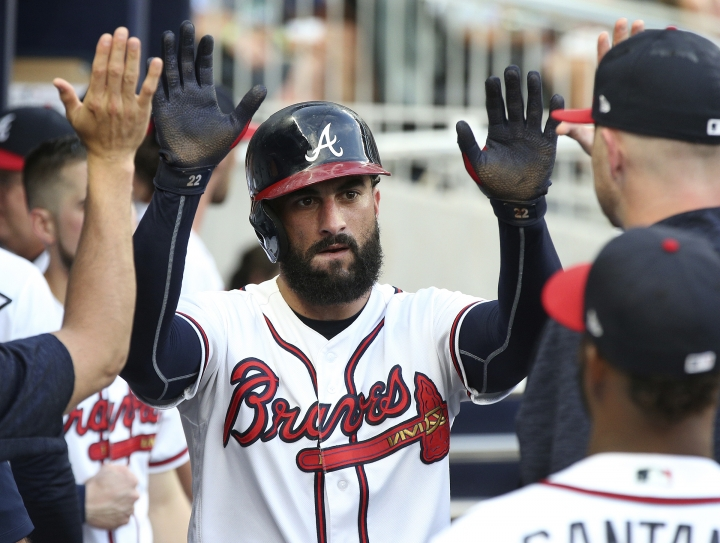 Atlanta Braves' Nick Markakis is congratulated after scoring against the Toronto Blue Jays during the second inning of a baseball game Wednesday, July 11, 2018, in Atlanta. (Curtis Compton/Atlanta Journal-Constitution via AP)