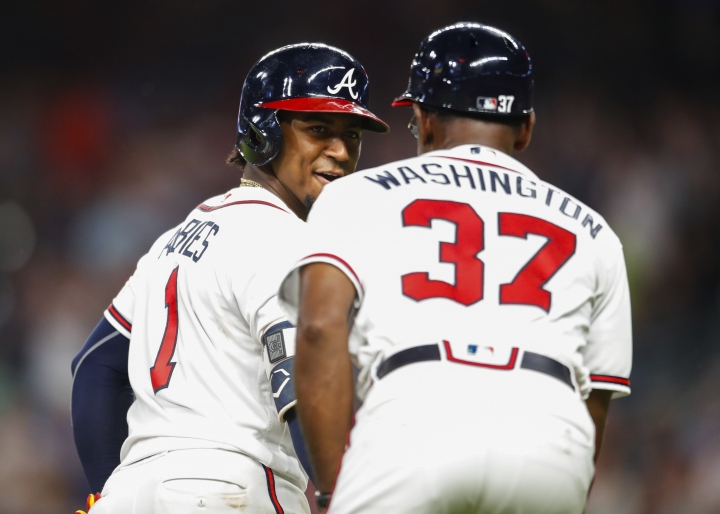 Atlanta Braves' Ozzie Albies (1) rounds third and shakes hands with third base coach Ron Washington (37) after hitting a solo home run during the sixth inning of a baseball game against the Toronto Blue Jays, Wednesday, July 11, 2018, in Atlanta. (AP Photo/Todd Kirkland)