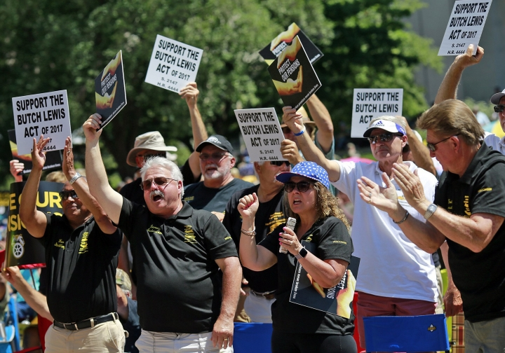 People cheer while appearing in support of pensions during a rally at the Ohio Statehouse in Columbus, Ohio, Thursday, July 12, 2018. The nation's burgeoning pension crisis has spurred thousands of workers and retirees to rally in Ohio's capital. Unionized coal and steel miners, teamsters, bakers, tobacco workers and others filled the lawn and steps of the Ohio Statehouse a day ahead of a congressional field hearing on the issue. (Brooke LaValley/The Columbus Dispatch via AP)