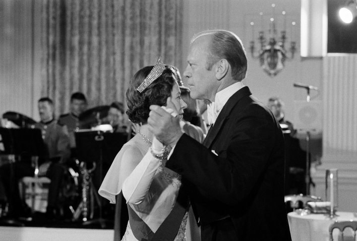 FILE - In this file photo dated July 7, 1976, U.S. President Gerald Ford dances with Britain's Queen Elizabeth II in the State Dining Room at the White House, following a State Dinner in the queen's honor. US President DonaldTrump enjoys flouting diplomatic rules and expressing himself in bold and sometimes mocking tweets and comments, but that side of his personality is unlikely to surface when he takes tea Friday, July 13, 2018 with Queen Elizabeth II. The president and his wife Melania are not expected to make waves during the visit with the 92-year-old monarch, who has met every U.S. president since Dwight Eisenhower with the exception of Lyndon Johnson, who never visited Britain while in office. (AP Photo/John Duricka, File)