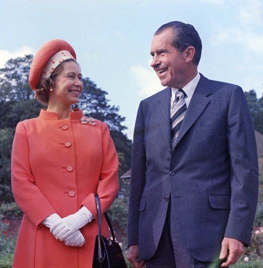 FILE - In this 1970 file photo, Britain's Queen Elizabeth II, left, reacts with U.S. President Richard Nixon, at Chequers, in Buckinghamshire, England. US President Donald Trump enjoys flouting diplomatic rules and expressing himself in bold and sometimes mocking tweets and comments, but that side of his personality is unlikely to surface when he takes tea Friday, July 13, 2018 with Queen Elizabeth II. The president and his wife Melania are not expected to make waves during the visit with the 92-year-old monarch, who has met every U.S. president since Dwight Eisenhower with the exception of Lyndon Johnson, who never visited Britain while in office. (AP Photo, File)