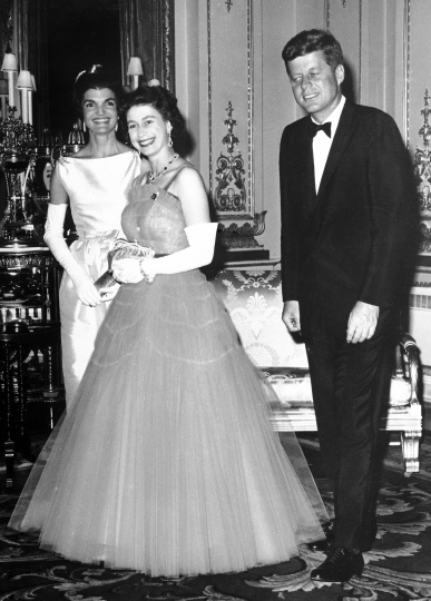 FILE - In this file photo dated June 5, 1961, Britain's Queen Elizabeth II, centre, walks with US President John F. Kennedy, right, and his wife Jacqueline Kennedy, as they enter an ante-room in Buckingham Palace, London, before a dinner given by the Queen in honour of the visiting President and his wife. US President Trump enjoys flouting diplomatic rules and expressing himself in bold and sometimes mocking tweets and comments, but that side of his personality is unlikely to surface when he takes tea Friday, July 13, 2018 with Queen Elizabeth II. The president and his wife Melania are not expected to make waves during the visit with the 92-year-old monarch, who has met every U.S. president since Dwight Eisenhower with the exception of Lyndon Johnson, who never visited Britain while in office. (AP Photo/File)