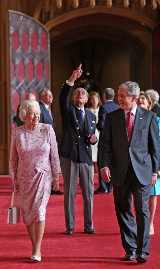 FILE - In this Sunday, June 15, 2008 file photo, Britain's Queen Elizabeth II and Prince Philip, the Duke of Edinburgh, pointing, walk with US President George Bush and his wife Laura, in St George's Hall, Windsor Castle, in Windsor, England. US President Trump enjoys flouting diplomatic rules and expressing himself in bold and sometimes mocking tweets and comments, but that side of his personality is unlikely to surface when he takes tea Friday, July 13, 2018 with Queen Elizabeth II. The president and his wife Melania are not expected to make waves during the visit with the 92-year-old monarch, who has met every U.S. president since Dwight Eisenhower with the exception of Lyndon Johnson, who never visited Britain while in office. (Nick Ray, Pool Photo via AP, File)