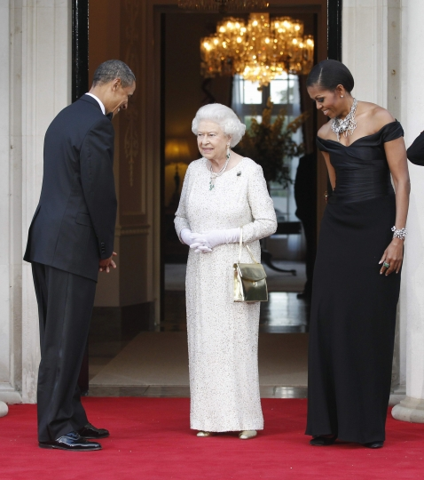 FILE - In this Wednesday, May 25, 2011 file photo, US President Barack Obama and first lady Michelle Obama welcome Britain's Queen Elizabeth II for a reciprocal dinner at Winfield House in London. US President Trump enjoys flouting diplomatic rules and expressing himself in bold and sometimes mocking tweets and comments, but that side of his personality is unlikely to surface when he takes tea Friday, July 13, 2018 with Queen Elizabeth II. The president and his wife Melania are not expected to make waves during the visit with the 92-year-old monarch, who has met every U.S. president since Dwight Eisenhower with the exception of Lyndon Johnson, who never visited Britain while in office. (AP Photo/Charles Dharapak, File)
