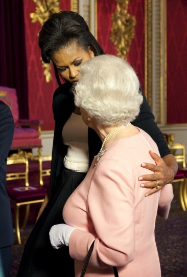 FILE - In this Wednesday, April 1, 2009 file photo, Michelle Obama, wife of U.S. President Barack Obama, left, walks with Britain's Queen Elizabeth II at the reception at Buckingham Palace in London. US President Trump enjoys flouting diplomatic rules and expressing himself in bold and sometimes mocking tweets and comments, but that side of his personality is unlikely to surface when he takes tea Friday, July 13, 2018 with Queen Elizabeth II. The president and his wife Melania are not expected to make waves during the visit with the 92-year-old monarch, who has met every U.S. president since Dwight Eisenhower with the exception of Lyndon Johnson, who never visited Britain while in office. (Daniel Hambury, Pool Photo via AP, File)
