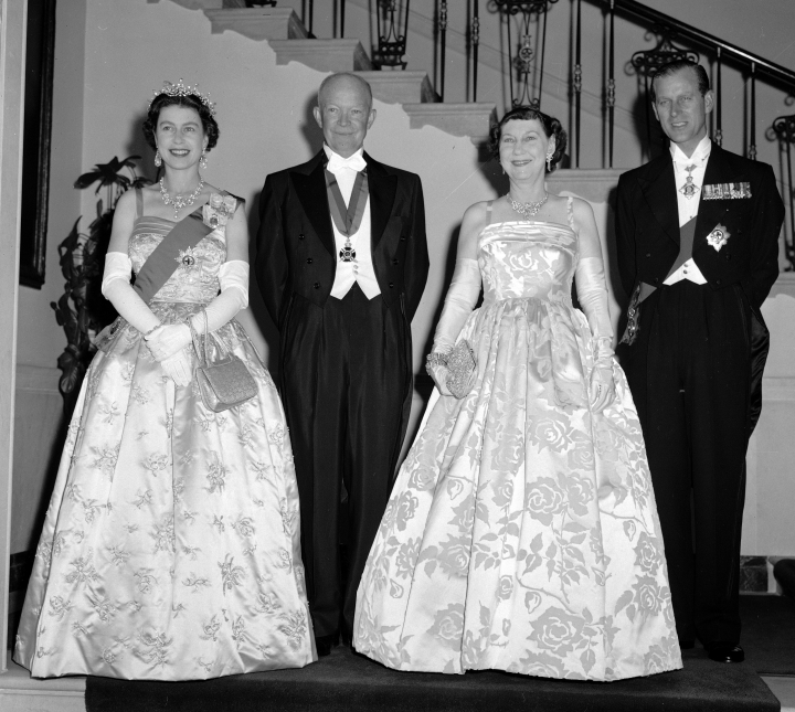 FILE - In this file photo dated Oct. 17, 1957, President Dwight Eisenhower, second left and first lady Mamie, second right are flanked by their royal guests, Britain's Queen Elizabeth II and her husband, Prince Philip, at the White House, in Washington. US President Trump enjoys flouting diplomatic rules and expressing himself in bold and sometimes mocking tweets and comments, but that side of his personality is unlikely to surface when he takes tea Friday, July 13, 2018 with Queen Elizabeth II. The president and his wife Melania are not expected to make waves during the visit with the 92-year-old monarch, who has met every U.S. president since Dwight Eisenhower with the exception of Lyndon Johnson, who never visited Britain while in office. (AP Photo, File)