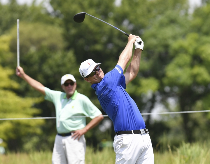 Zach Johnson tees off on the ninth hole during the first-round of the John Deere Classic golf tournament Thursday, July 12, 2018, in Silvis, Ill. (Todd Mizener/The Dispatch - The Rock Island Argus via AP)