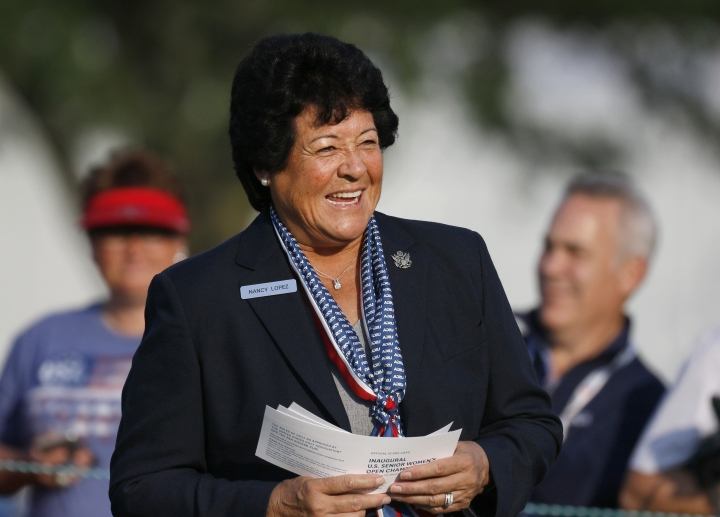 Nancy Lopez announces golfers during the first round of the inaugural U.S. Senior Women's Open golf tournament in Wheaton, Ill., Thursday, July 12, 2018. (Daniel White/Daily Herald via AP)
