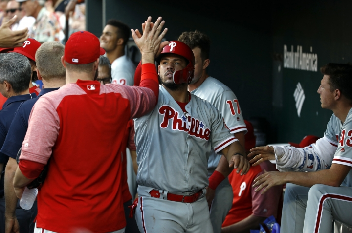 Philadelphia Phillies' Jorge Alfaro high-fives teammates in the dugout after scoring on Carlos Santana's single during the third inning of a baseball game against the Baltimore Orioles, Thursday, July 12, 2018, in Baltimore. (AP Photo/Patrick Semansky)
