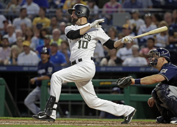 Pittsburgh Pirates' Jordy Mercer watches his two-run single off Milwaukee Brewers relief pitcher Adrian Houser during the sixth inning of a baseball game in Pittsburgh, Thursday, July 12, 2018. (AP Photo/Gene J. Puskar)