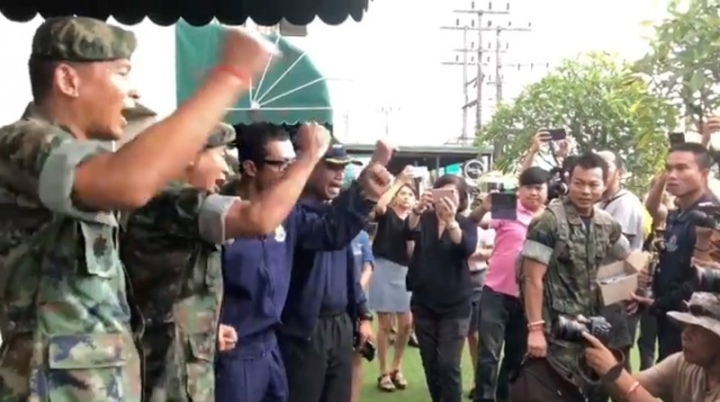 Military officers do the Hooyah in the Northern Province of Chiang Rai, Thailand July 12, 2018 in this still image taken from a video obtained from social media. THAI NAVY SEAL/via REUTERS