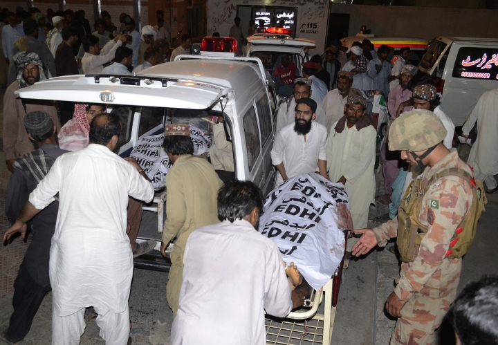People taking bodies of bombing victims to their villages for burial at a hospital in Quetta, Pakistan, Friday, July 13, 2018. --- Mourners take a bombing victims to their villages for burial, outside a hopsital in Quetta, Pakistan, Friday, July 13, 2018. In an attack in the nearby southwestern Baluchistan town of Mastung, Siraj Raisani a candidate in the provincial parliament, died when a suicide bomber blew himself up amid scores of supporters who had gathered at a rally. The Islamic State group claimed responsibility for the blast. (AP Photo/Arshad Butt)