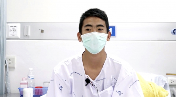 This image made from a video taken on July 13, 2018 and released by Chiang Rai Prachanukroh Hospital, shows Prajak Sutham, one of the 12 boys rescued from the flooded cave, in their hospital room at Chiang Rai Prachanukroh Hospital in Chiang Rai province, northern Thailand. The video was shown during a press conference at the hospital Saturday, July 14, 2018. (Chiang Rai Prachanukroh Hospital via AP)