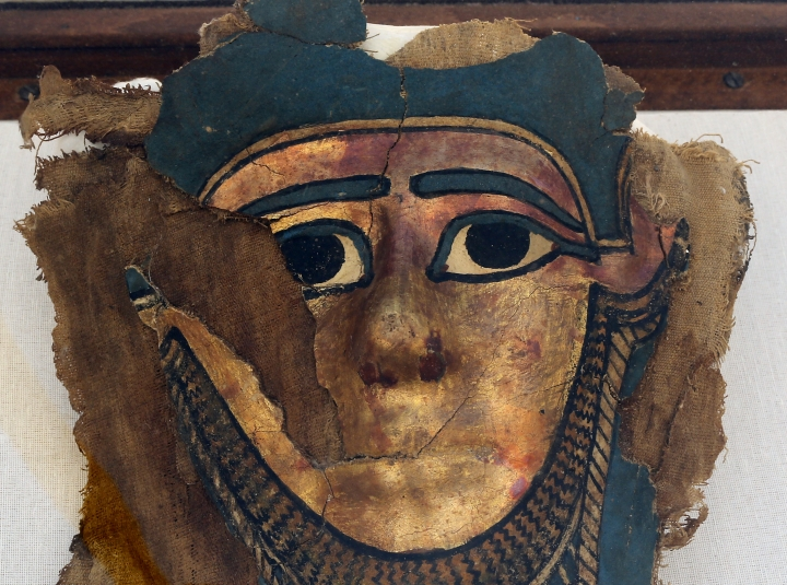 A recently discovered gilded mummy mask is displayed after it was found in a disturbed context of the hall way of a burial chamber dating back some 2,500 years at an ancient necropolis near Egypt's famed pyramids in Saqqara, Giza, Saturday, July 14, 2018. Antiquities Ministry officials said at a press conference that archaeologists hope the find will reveal more about the secrets of mummification in the 26th dynasty of ancient Egypt. (AP Photo/Amr Nabil)