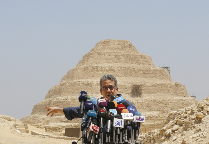 Antiquities Minister Khaled el-Anani, speaks during a press conference in front of the step pyramid of Saqqara, in Giza, Saturday, July 14, 2018. Archaeologists say they have discovered a mummification workshop dating back some 2,500 years at an ancient necropolis near Egypt's famed pyramids. (AP Photo/Amr Nabil)
