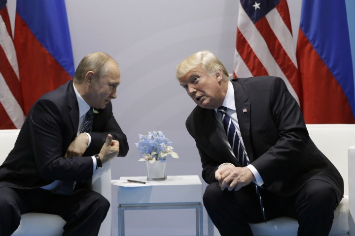 """FILE - In this July 7, 2017, file photo, President Donald Trump meets with Russian President Vladimir Putin at the G20 Summit in Hamburg. Trump seems of two minds about nuclear weapons. He has mused about their elimination. But he also has called for a U.S. buildup and bragged about his nuclear """"button."""" How these seemingly competing instincts will play out in his Helsinki talks with Putin on July 16, 2018, could profoundly affect the direction of U.S. defense policy. (AP Photo/Evan Vucci, File)"""