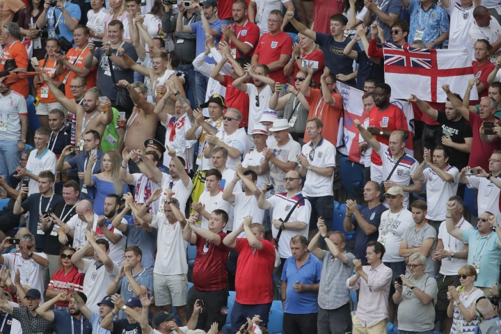 English fans applaud their players after the third place match between England and Belgium at the 2018 soccer World Cup in the St. Petersburg Stadium in St. Petersburg, Russia, Saturday, July 14, 2018. Belgium defeats England 2-0. (AP Photo/Dmitri Lovetsky)