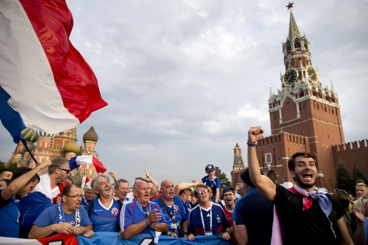 France fans celebrate in Red Square in eve of the final soccer match Croatia and France during the 2018 soccer World Cup in Moscow, Russia, Saturday, July 14, 2018. (AP Photo/Alexander Zemlianichenko)